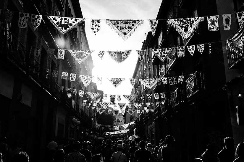 Madrid, Spain - August 15, 2016: Busy street in La Latina during the annual festivities of La Paloma, with the traditional mantillas decorating the street.